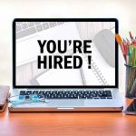 "Laptop screen that says, ""You're Hired!"""